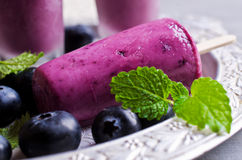 Homemade popsicle blueberry. And cream. Selective focus stock image
