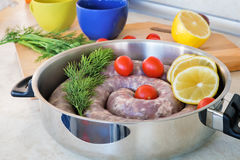 Homemade pork sausage in a frying pan for a roast. Stock Images