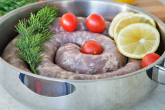 Homemade pork sausage in a frying pan for a roast. Stock Photo