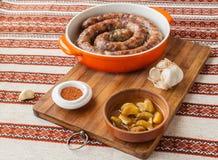 Homemade pork sausage with roasted garlic Royalty Free Stock Photos