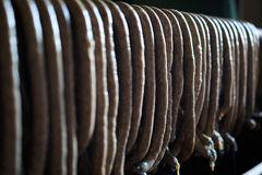 Homemade pork sausages hanging in the smokehouse Royalty Free Stock Image