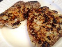 Homemade Pork Steak. Enjoying Homemade Pork Steak Stock Photos