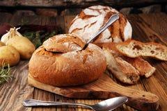 Homemade potato cream soup, served in bread bowl. Homemade potato cream soup, served in bread bowl stock photos