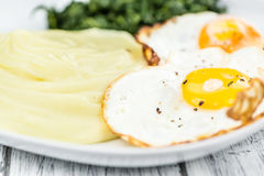Homemade Potato Mash with fried eggs and spinach Royalty Free Stock Image