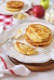 Homemade potato pancakes with apple puree. Two portions Stock Photos
