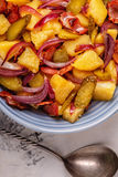 Homemade potato salad with bacon and pickles. stock image