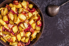 Homemade potato salad with bacon and pickles. Stock Photo