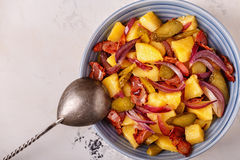 Homemade potato salad with bacon and pickles. royalty free stock photography