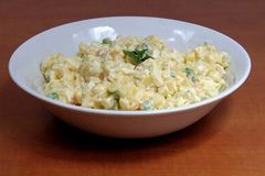 Homemade potato salad in white ceramic plate Stock Photography