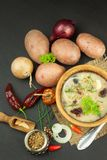 Homemade potato soup with mushrooms. Bowl with potato soup on wooden table. Food preparation. Royalty Free Stock Photo