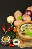 Homemade potato soup with mushrooms. Bowl with potato soup on wooden table. Food preparation. Stock Photo