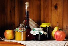 Homemade preserves. Still life of homemade preserves and fresh fruits Stock Photos