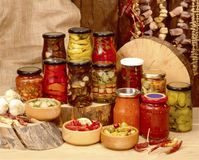 Homemade Preserves. Sitting on a rustic table outside. pickes, tomatoes, appplesauce, etc Royalty Free Stock Image