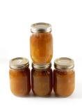 Homemade Preserves. Stacked jars of homemade apple butter Stock Photos