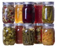 Homemade preserves and pickles. Group of homemade preserves canned goods in mason jars Royalty Free Stock Images
