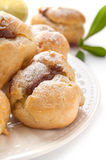 Homemade profiteroles with chocolate cream Royalty Free Stock Image