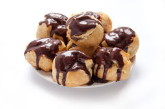 Homemade profiteroles with chocolate cream Stock Image