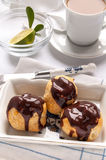 Homemade profiteroles with chocolate cream Royalty Free Stock Photos