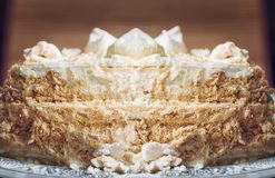 A homemade puff cake with meringue on a white plate stock photography