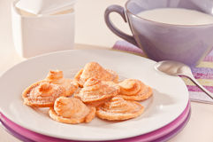 Homemade puff pastry cookies with milk. Homemade puff pastry cookies on a white plate with milk Royalty Free Stock Image