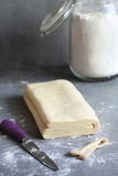 Homemade puff pastry dough on a floured surface Stock Photos