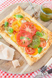 Homemade puff pastry with fresh tomatoes Royalty Free Stock Photography