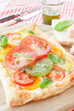 Homemade puff pastry with fresh tomatoes Stock Images