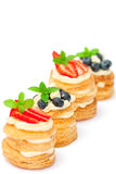 Homemade puff pastry stuffed with cream and berries on white Royalty Free Stock Photography