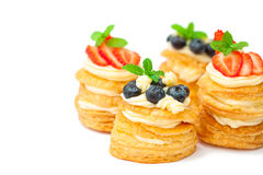 Homemade puff pastry stuffed with cream and berries on white Royalty Free Stock Images