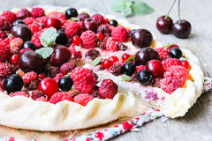 Homemade puff pastry sweet pie with fresh cherry, raspberry, black currant and strawberry with cream cheese decorated Royalty Free Stock Photos