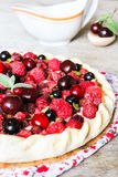 Homemade puff pastry sweet pie with fresh cherry, raspberry, black currant and strawberry with cream cheese decorated Stock Images
