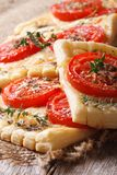 Homemade puff pastry with tomatoes, cheese and herbs vertical Stock Photography