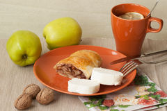 Homemade puff pie with apples and tea, lemon Stock Images