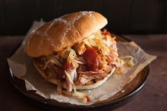 Homemade pulled pork burger with caramelized onion and bbq sauce Stock Photos
