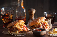 Homemade pulled pork burger with caramelized onion and bbq sauce Royalty Free Stock Photo