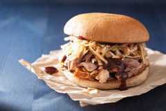 Homemade pulled pork burger with coleslaw and bbq sauce.  stock photo