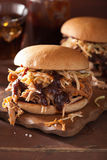 Homemade pulled pork burger with coleslaw and bbq sauce Royalty Free Stock Photography