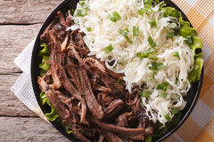 Homemade Pulled pork with sauerkraut closeup. horizontal top vie Royalty Free Stock Photo