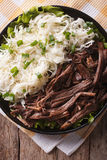 Homemade Pulled pork with sauerkraut closeup. vertical top view Royalty Free Stock Photos