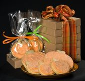 Homemade pumkin cookies on  black. Background Royalty Free Stock Images