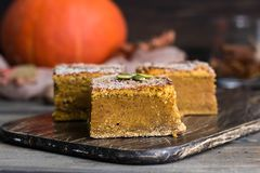 Homemade pumpkin bars with sugar-cinnamon crust. For the holiday and for every day stock photo