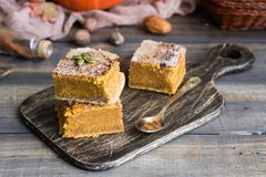 Homemade pumpkin bars with sugar-cinnamon crust. For the holiday and for every day royalty free stock photo