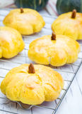 Homemade pumpkin buns on a cooling rack Royalty Free Stock Photo