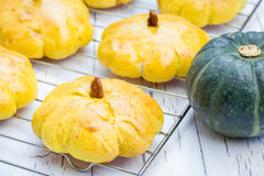 Homemade pumpkin buns on a cooling rack Stock Photography