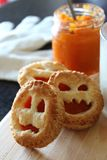Homemade pumpkin cookie on funny faces for Halloween. Autumn snak royalty free stock photography