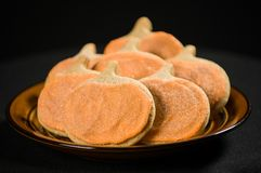 Homemade pumpkin cookies on  black Stock Photos