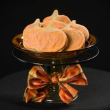 Homemade pumpkin cookies on  black. Background Royalty Free Stock Photography