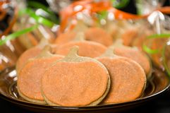 Homemade pumpkin cookies on  black. Background Royalty Free Stock Image