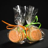 Homemade pumpkin cookies on  black. Background Royalty Free Stock Images