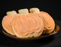 Homemade pumpkin cookies on  black. Background Stock Photos